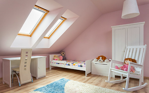 Child's bedroom in loft conversion - pink, with Velux windows
