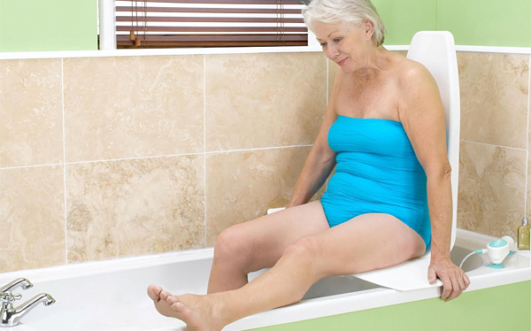 Woman using motorised bath lift