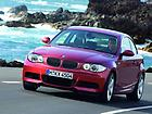 BMW 1 Series coupe red driving f3q 2