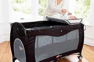 Travel cot with mesh sides