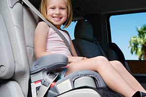 Girl sitting in a booster seat